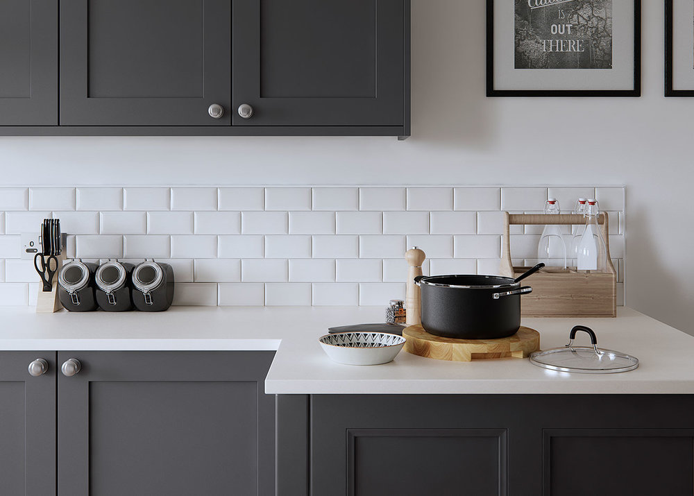 Shaker cabinets with subway tiles for a more traditional kitchen.  Matt white stone bench tops and beautiful grey 2 pac doors give this look a modern edge.