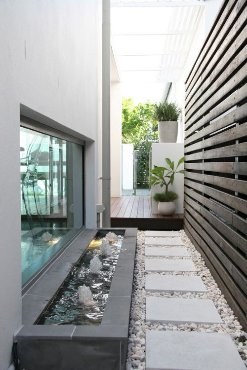 Side ways can be tricky.  This water feature is a clever idea to break up the long space.