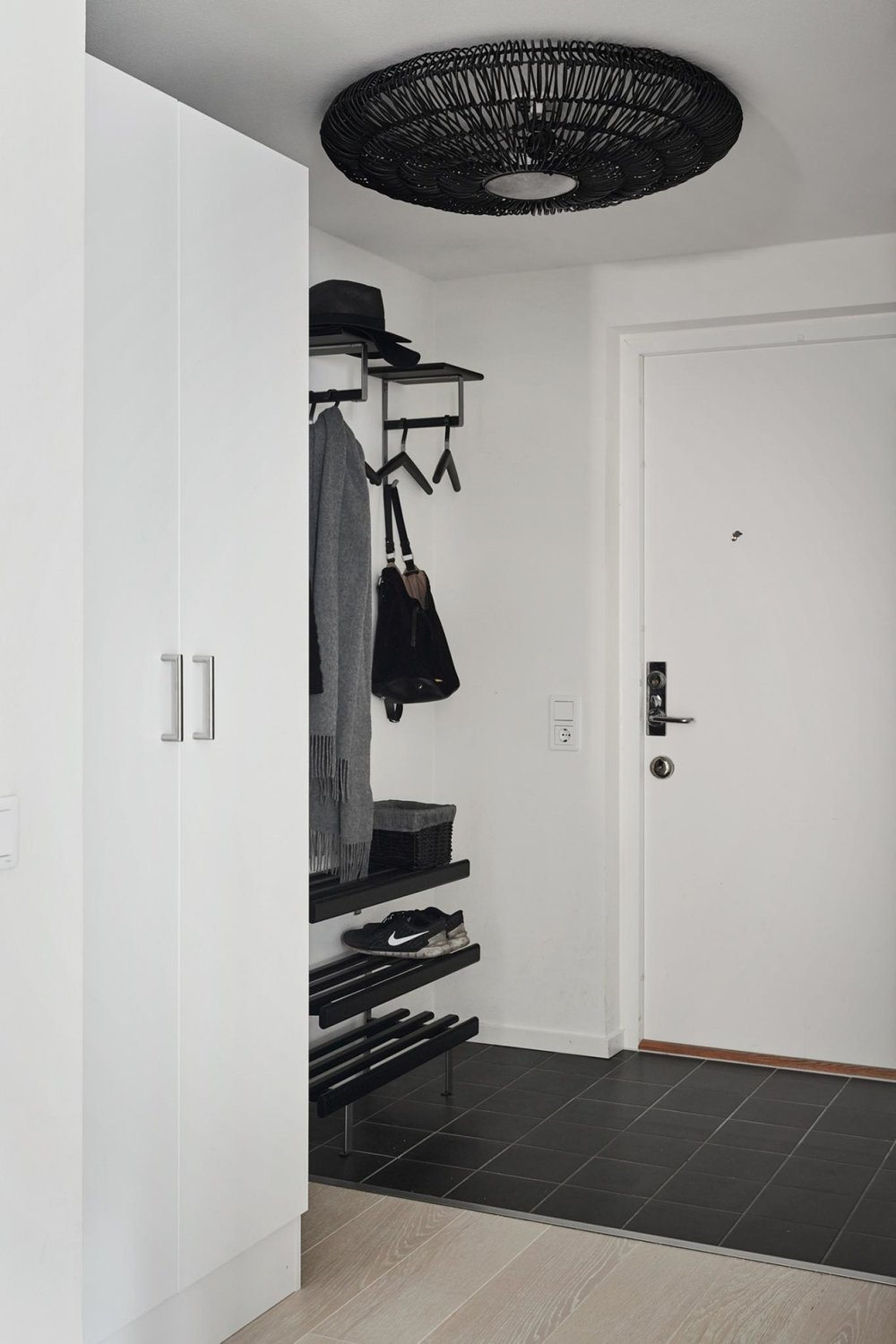 "Open storage = easy access.  make the most of your entry and live in the space with ease.   As long as its kept neat, this idea is a winner.  When you enter and exit your space its a visula reminder of what you need.  Did somoneone say ""where's the keys?""  nope...not here."