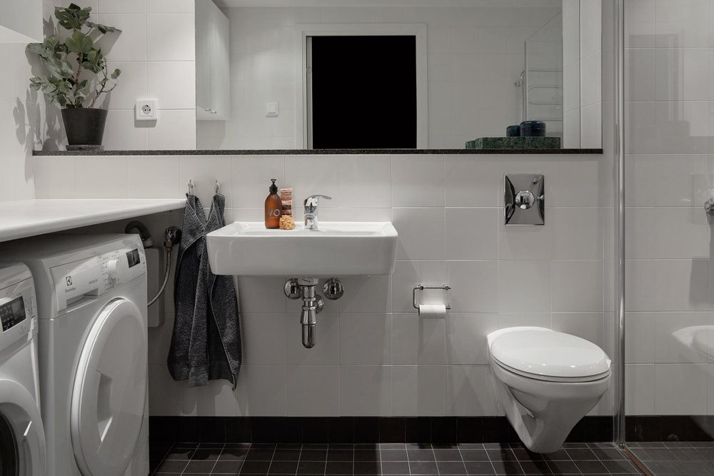 - Bathroom storage can be maximised if you keep the basin small and add a shaving cabinet and overheads in the European laundry area.Its tight but works!Note that the colour palate is simple which adds to the appeal of a busy space.