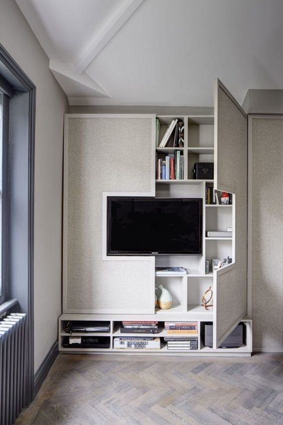 When space is at a premium....build in.   The TV wall can be crammed full of your favourinte things and yet neat and tidy at the same time.