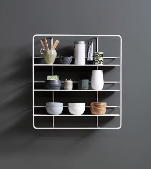Simple wall mounted storage that is as sculptural as it is practical.