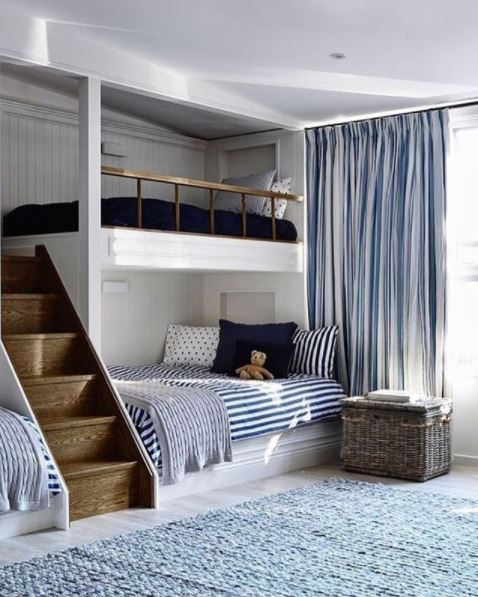 While bunks are a space saver, getting up to them is often frustrating.  I love this idea of the stairs.  Its visually interesting and feels like you just want to jump up there.  Stacking the beds into your holiday home never looked better.