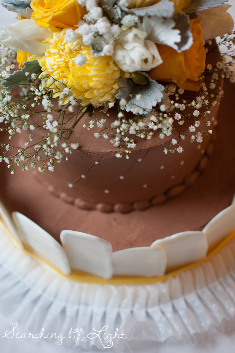 chocolate wedding cake yellow and gray wedding colors with baby's breath flowers