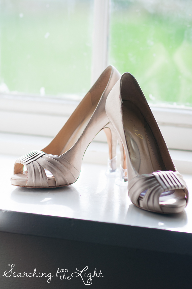 wedding shoes in a window Lakewood stone house wedding photos by Denver wedding photographer searchingforthelight.com