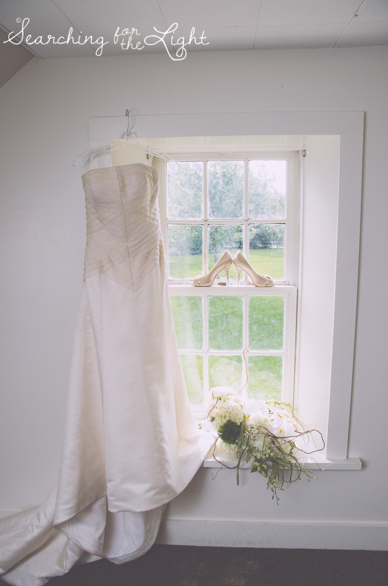 wedding clothes in a window Lakewood stone house wedding photos by Denver wedding photographer searchingforthelight.com