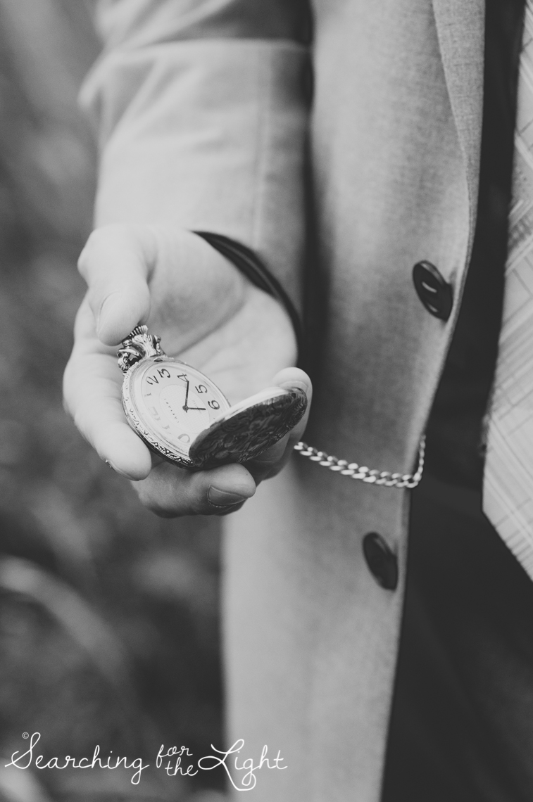 Groom carrying grandfather's pocket watch Lakewood stone house wedding photos by Denver wedding photographer searchingforthelight.com