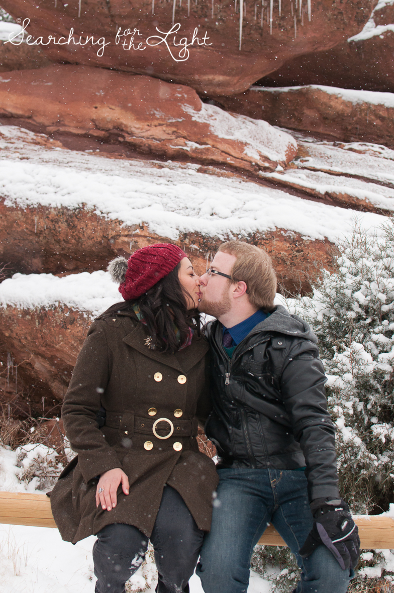 winter engagement photos at Red rocks by Denver wedding photographer searchingforthelight.com
