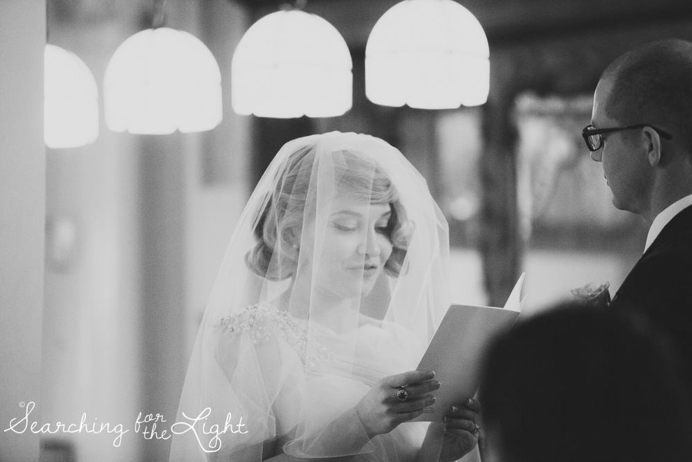 reading wedding vows indoor ceremony at Parkside mansion wedding photo by denver wedding photographer, romantic evening wedding photo, city wedding