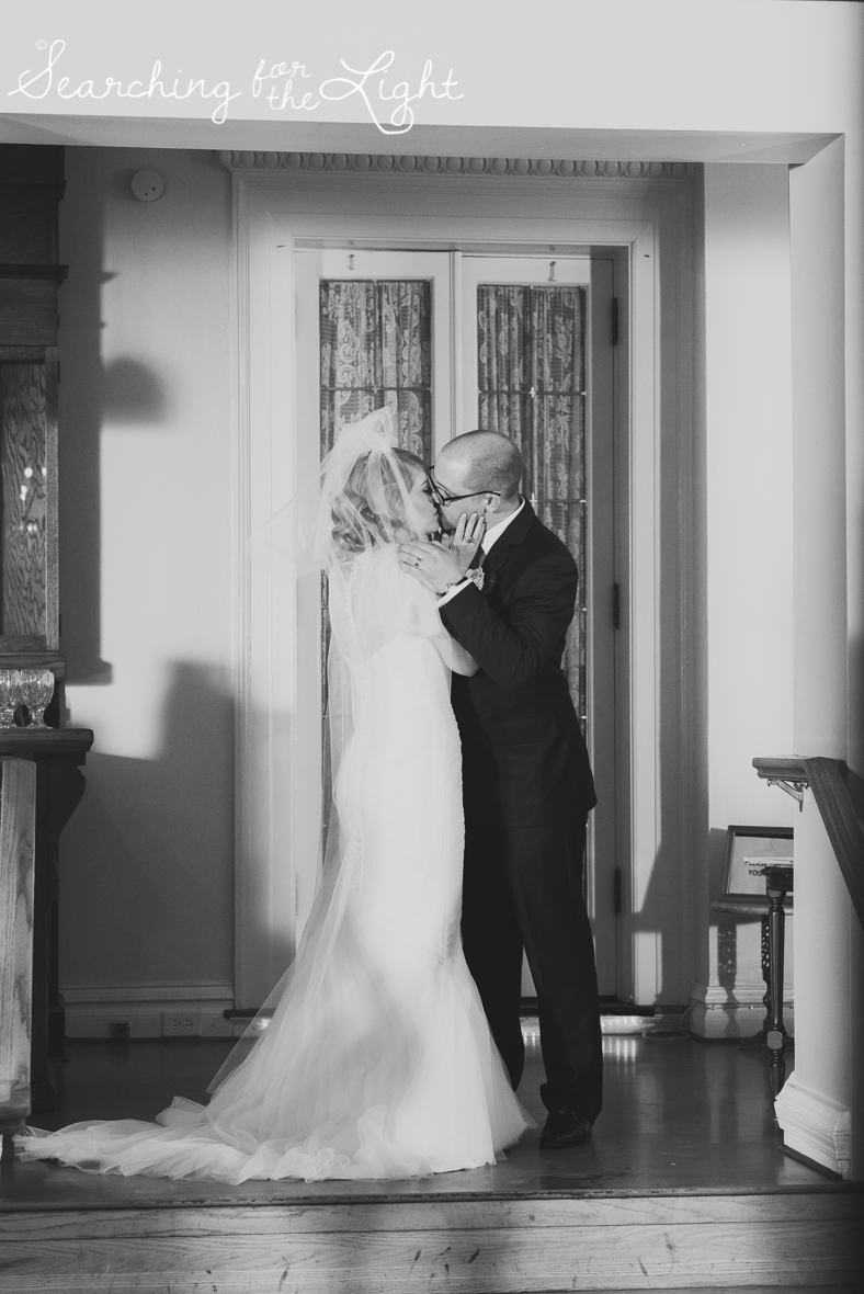 first kiss indoor ceremony at Parkside mansion wedding photo by denver wedding photographer, romantic evening wedding photo, city wedding