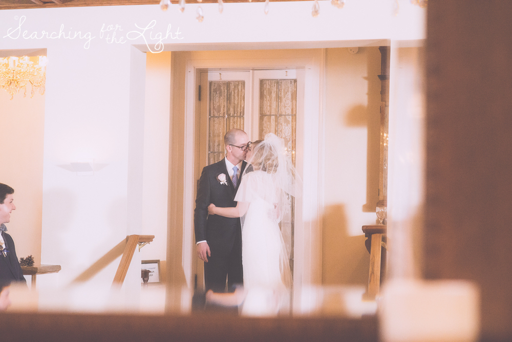 indoor ceremony at Parkside mansion wedding photo by denver wedding photographer, romantic evening wedding photo, city wedding