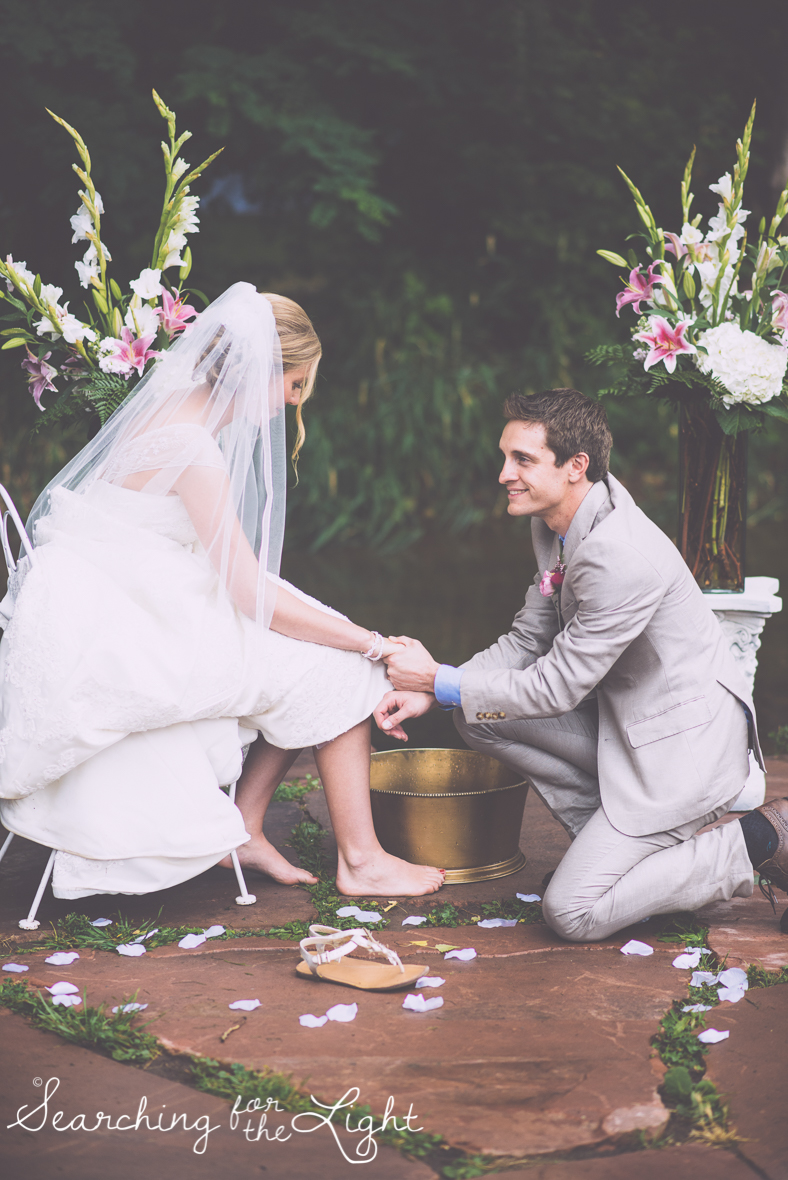 Foot washing at your wedding ceremony, lyons farmette wedding by colorado wedding photographer