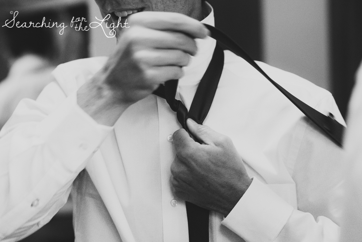 groom getting ready at Holy Ghost Catholic church, colorado wedding photographer photos