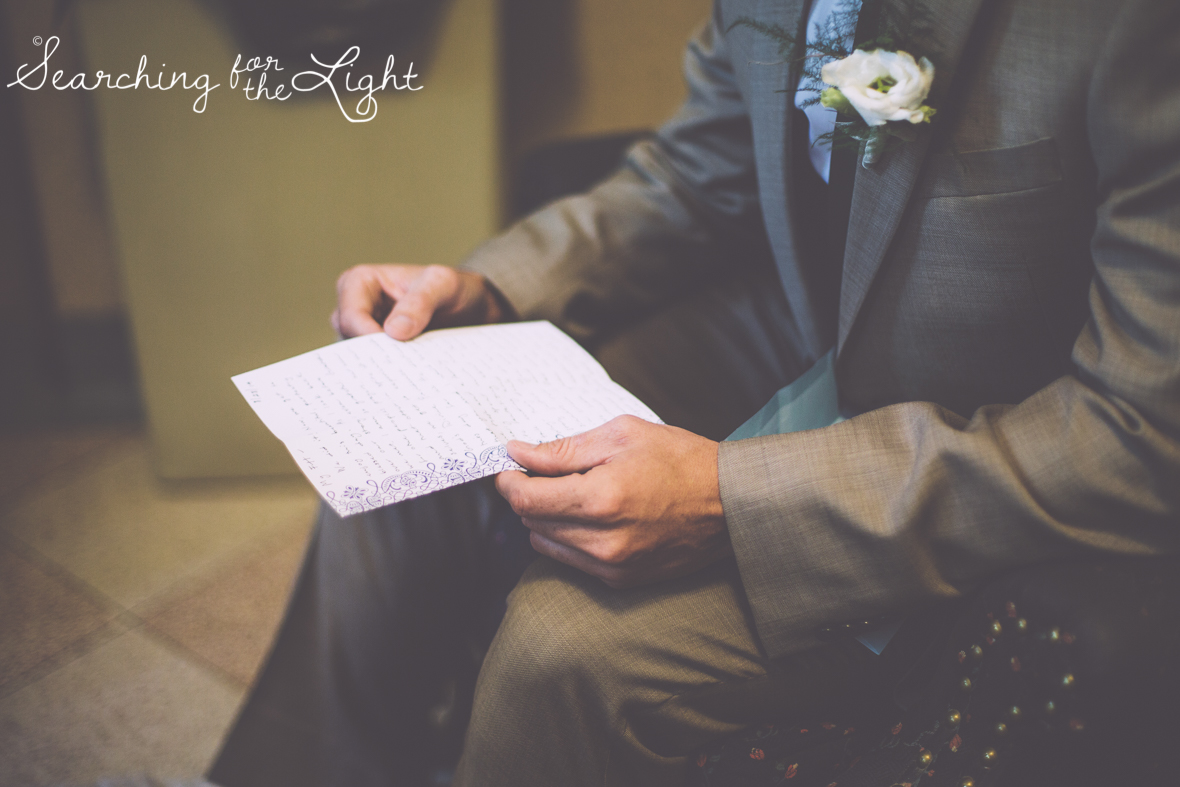 groom reading note from bride at Holy Ghost Catholic church, colorado wedding photographer photos