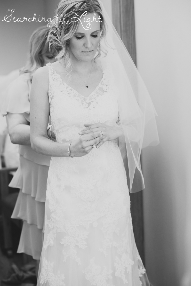bride getting dressed photo at Holy Ghost Catholic church, colorado wedding photographer photos