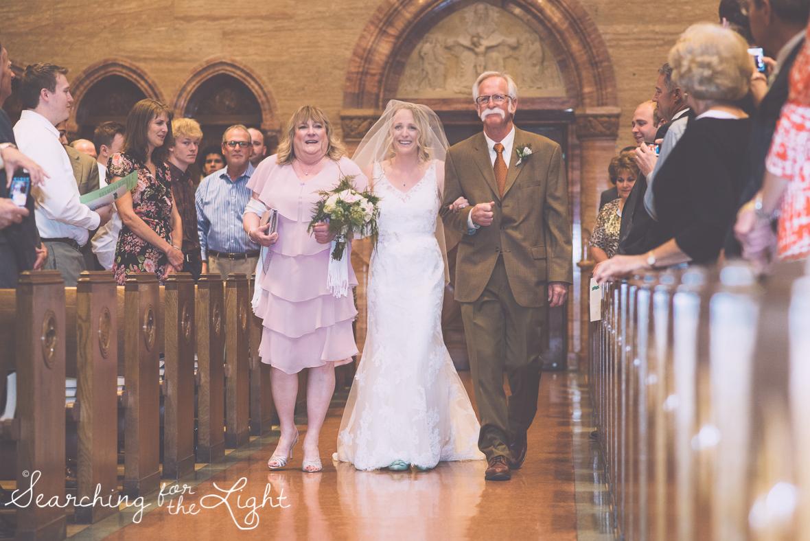 bride walking down aisle at a church wedding photos, colorado wedding photographer