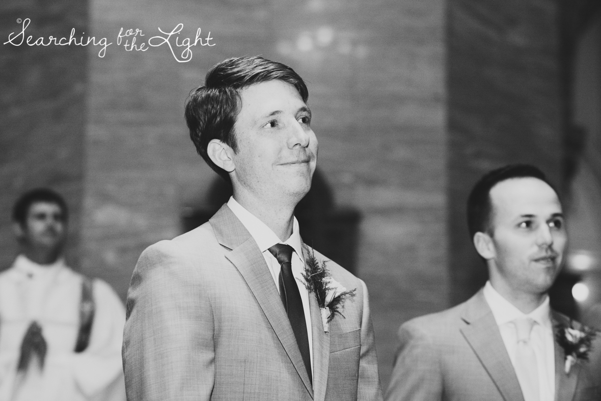groom seeing his bride for the first time photo at a church wedding photos, colorado wedding photographer