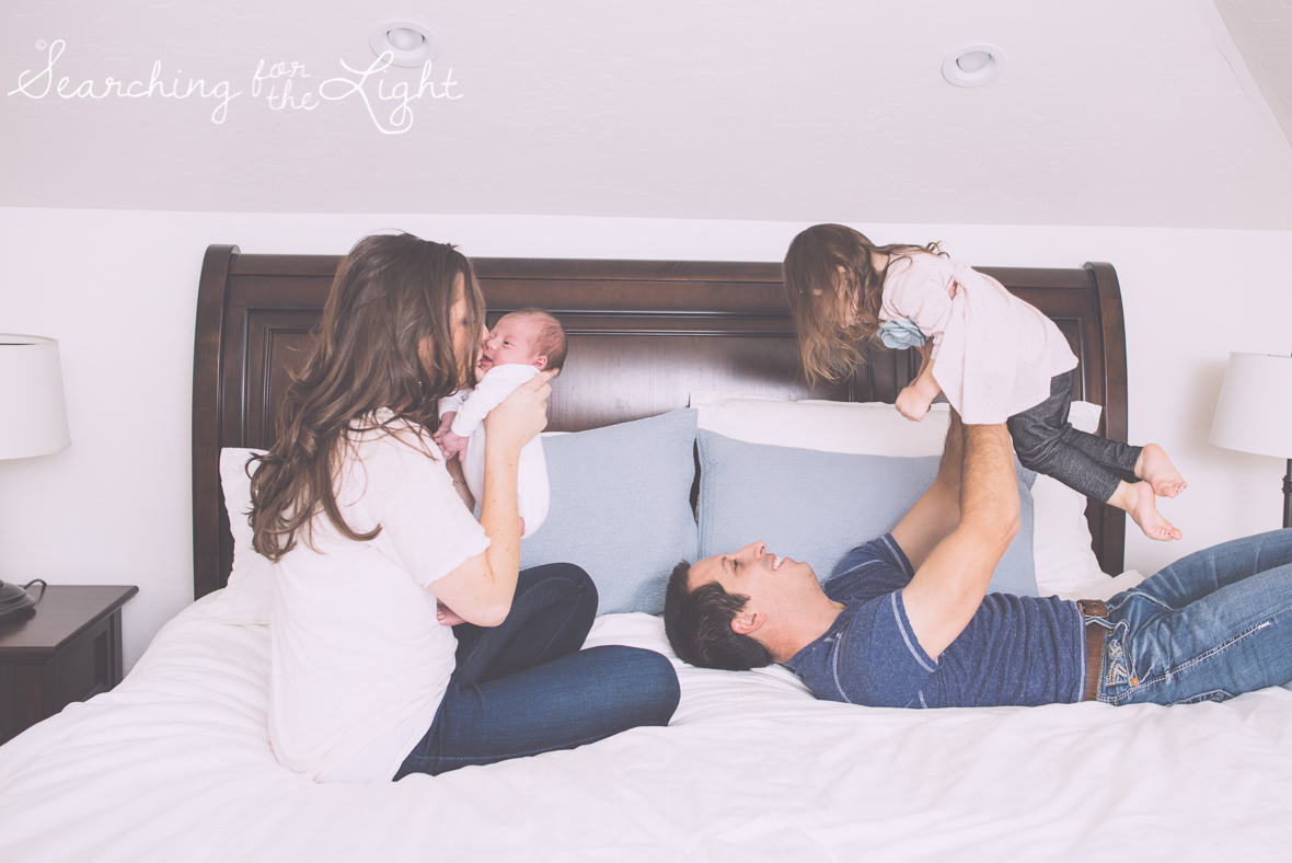 Denver newborn photographer, Newborn photos, family winter photos, bedroom family photos,