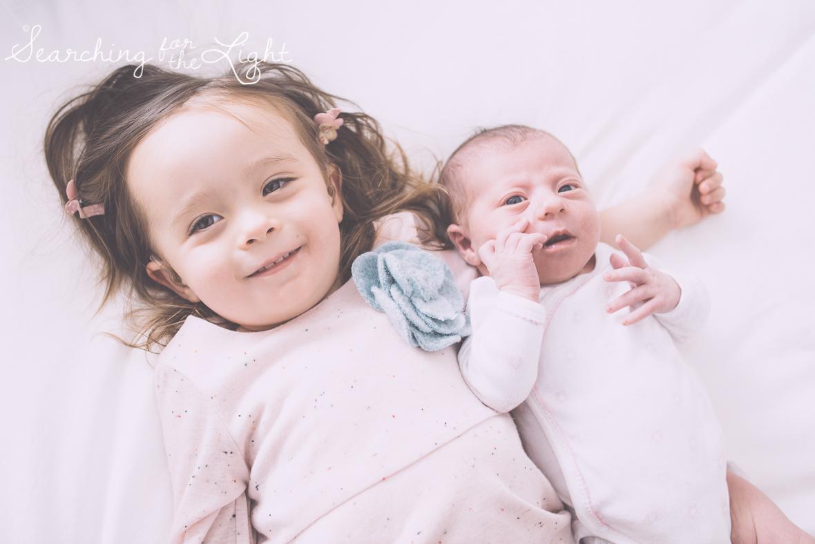 Denver newborn photographer, Newborn photos, family winter photos, bedroom family photos, sisters photos