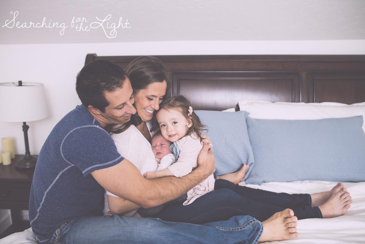Denver newborn photographer, Newborn photos, family winter photos, bedroom family photos