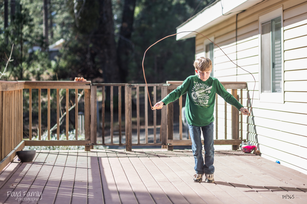 jumping rope in your backyard summer activities - Placerville-Children-Photographer