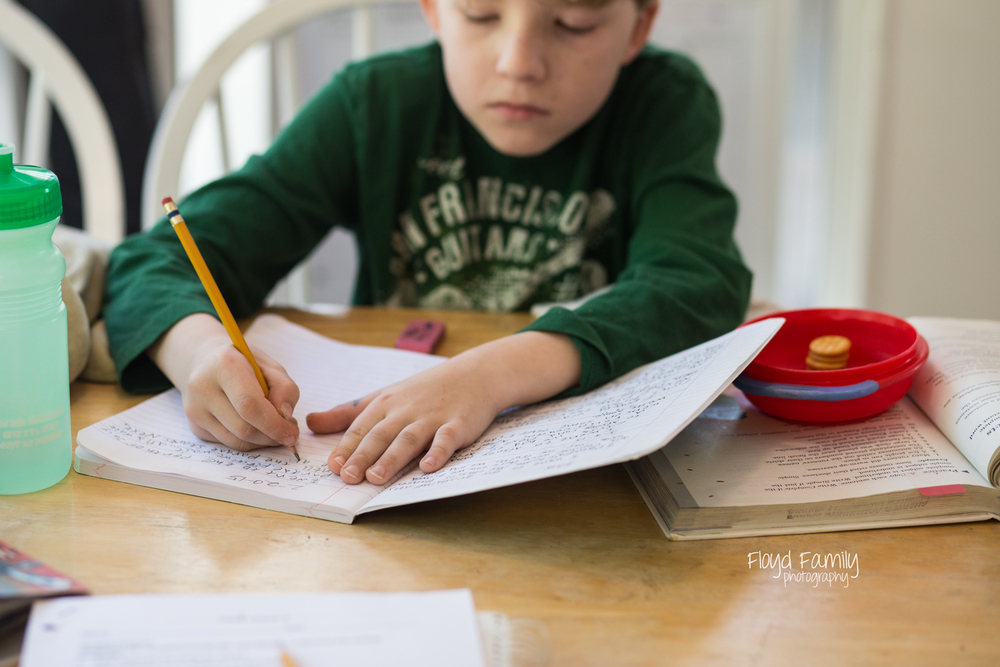boy writing in journal and kitchen table | Placerville-Children-Photographer