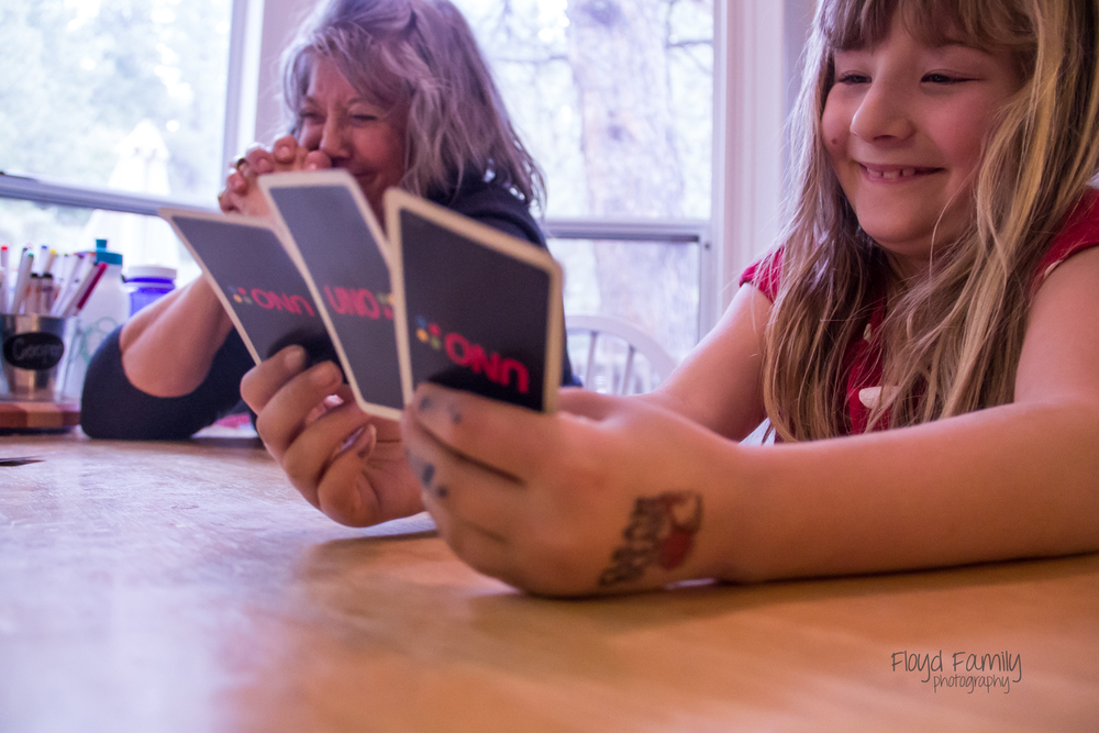 sitting at the kitchen table playing UNO | Placerville-Children-Photographer
