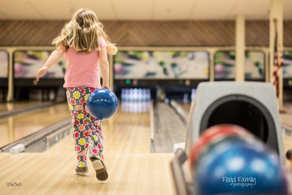 girl bowling with hair swinging | Placerville-Children-Photographer