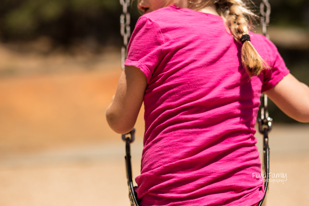 Daughter winging on the swings | Placerville-Children-Photographs