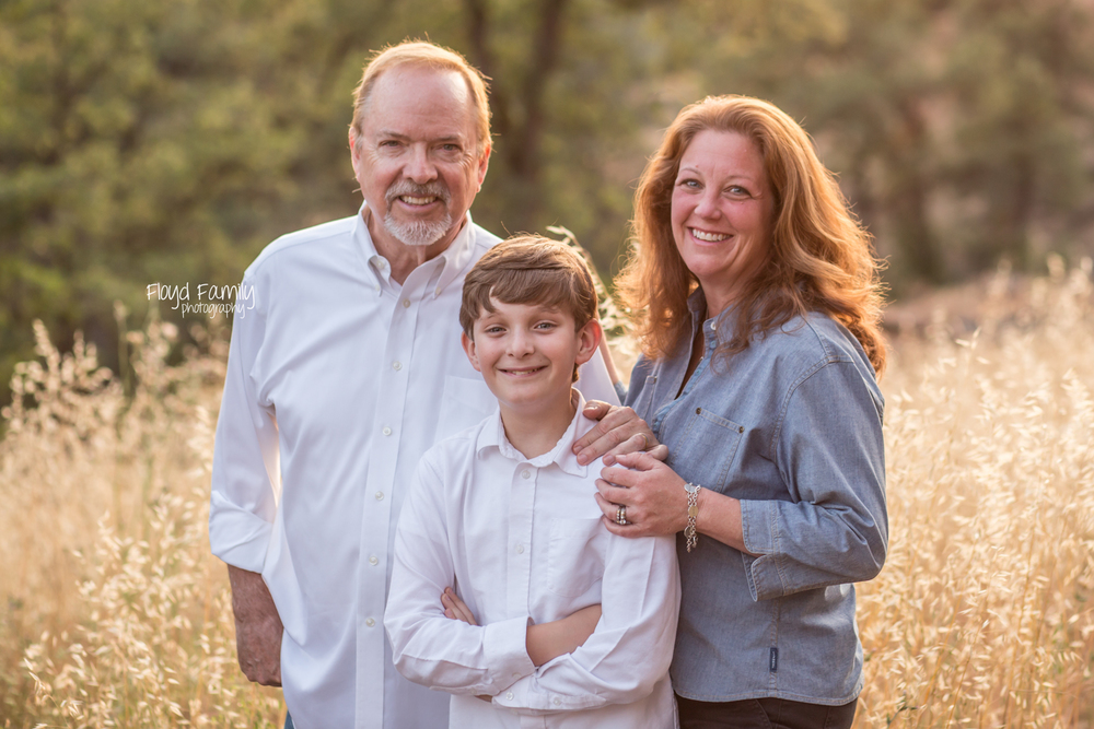 family of three backlit in front of field | Placerville-Children-Photography