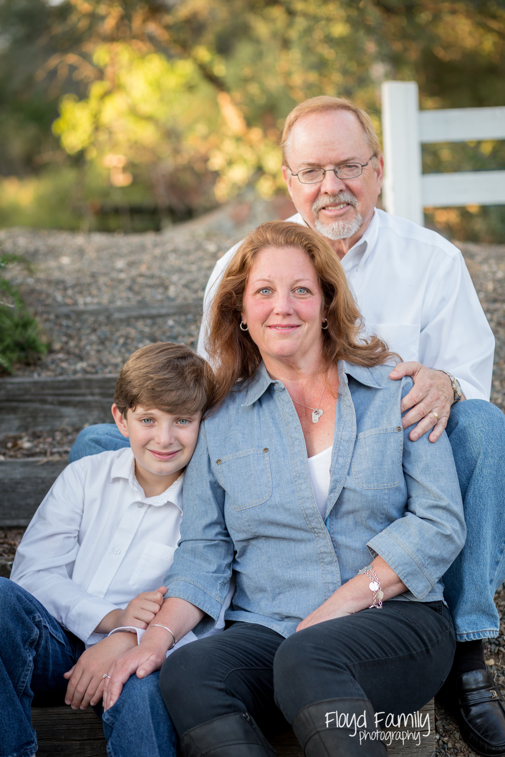 Family of three sitting on steps | Placerville-Children-Photography