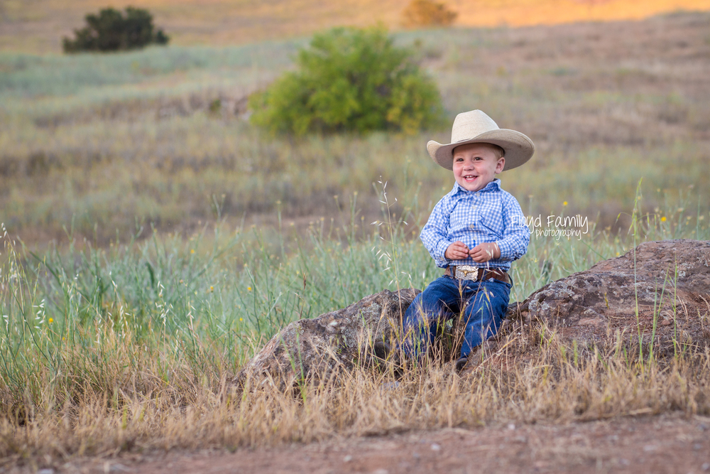 Toddler boy sitting on top of a rock in field | Placerville Documentary Family Photography