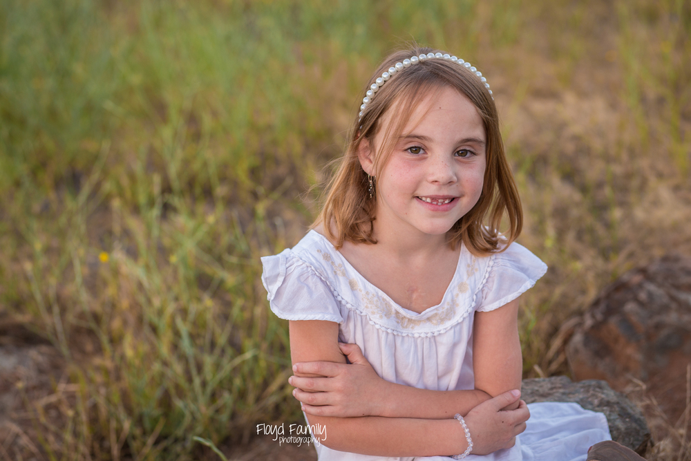 Girl sitting on top of a rock in field | Placerville Documentary Family Photography