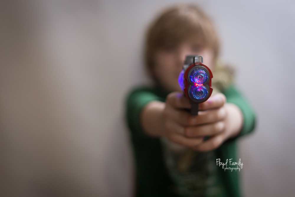 light from the side boy playing with toy gun