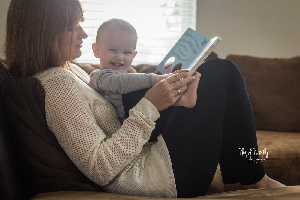mom reading to son on couch