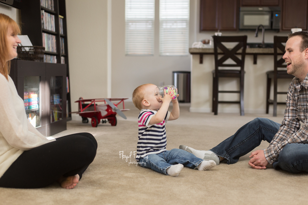 toddler boy doing funny things while parents laugh
