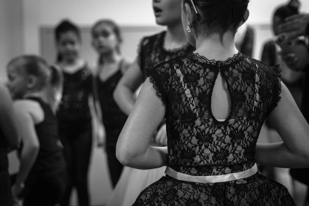 Black and white photo of little girl in dance dress eating to dance at recital | Portraits El Dorado Hills Family