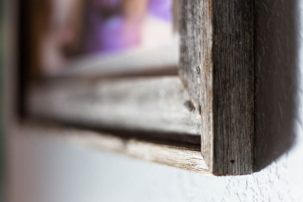 Close up of framed barn wood print on wall of my house | El Dorado Hills Photographer Children