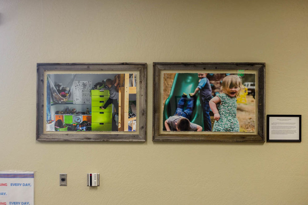 Documentary photos hanging in the Cameron park library