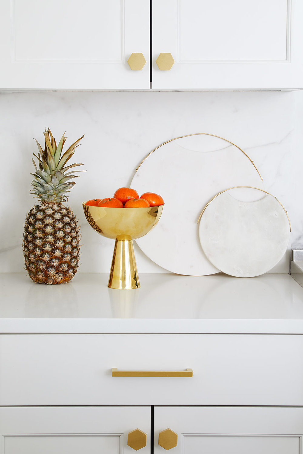 The pineapple motif has been in and out for years, and it's back again in 2018. You can find varieties of pineapple in print, table lamp shades, and more. Or, you could alway use the real thing.