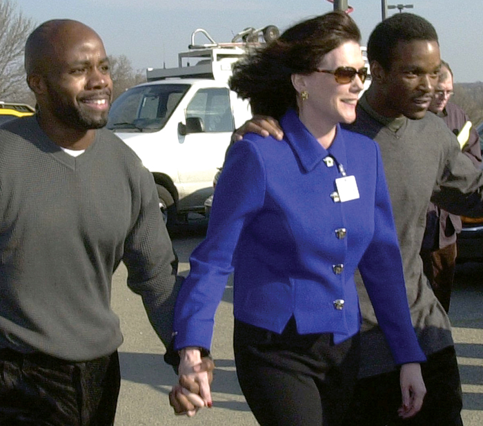"Zellner leaves the Stateville Correctional Center in Crest Hill with clients Omar Saunders (left) and Larry Ollins in 2001. Two members of the wrongly convicted ""Roscetti 4,"" they were released after DNA evidence showed they did not commit the 1986 kidnapping, rape and murder they were imprisoned for.  Photo by Associated Press/Stephen J. Carrera."