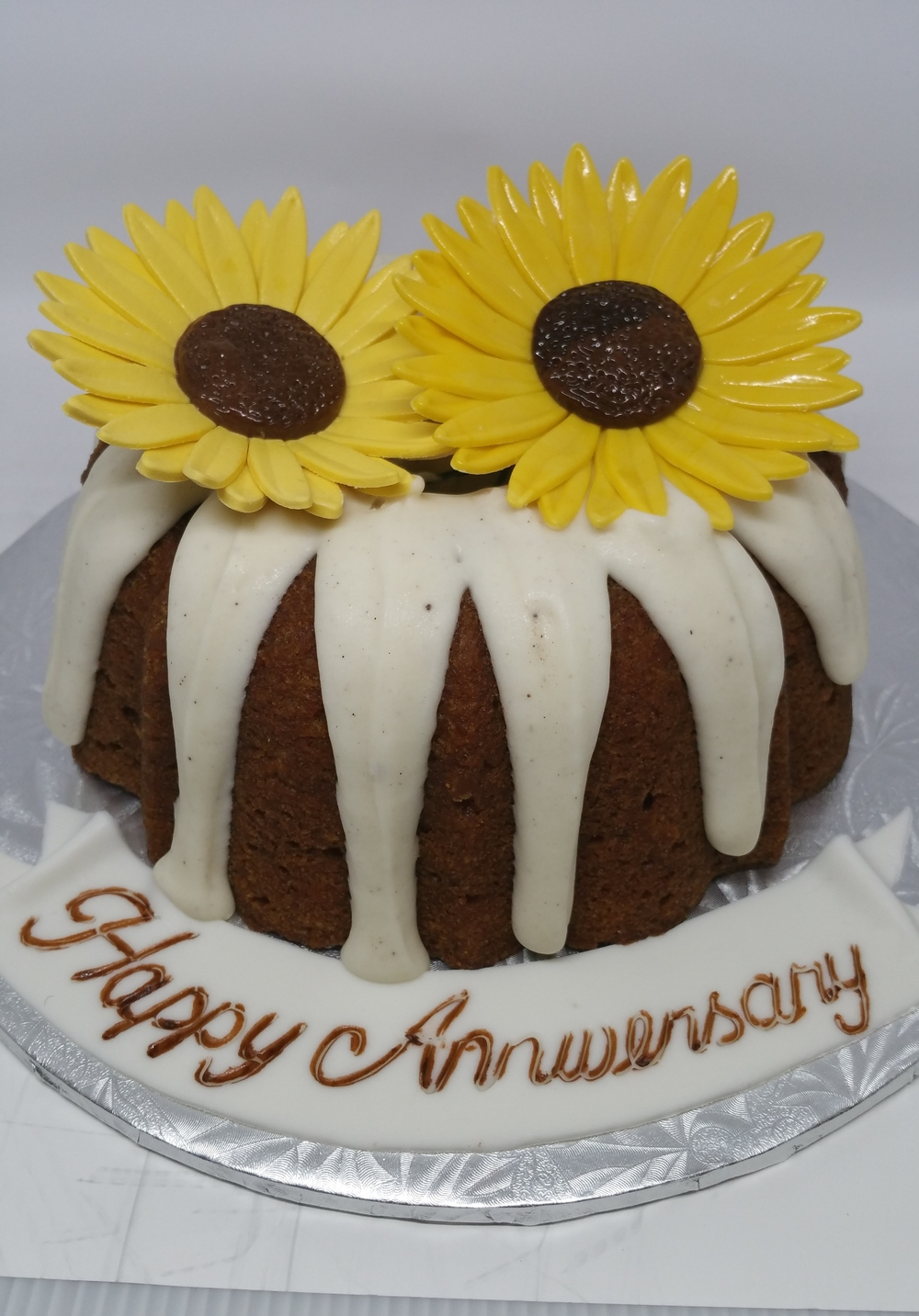 "8"" Bundt, Sugar Sunflowers are additional fee."