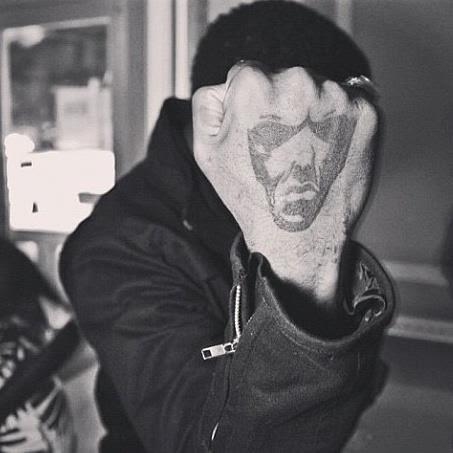 Grindstone Universal Logo Fist Tattoo.jpeg