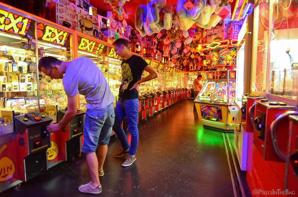 Men trying their luck at the carnival games.