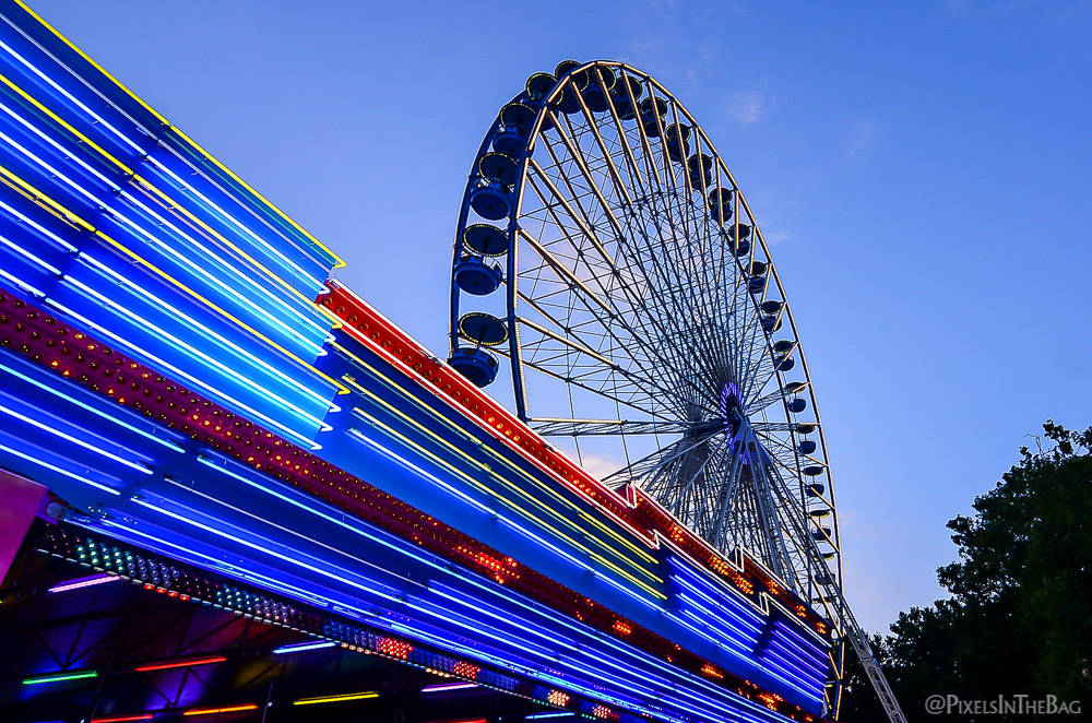 Electric blue Ferris wheel.
