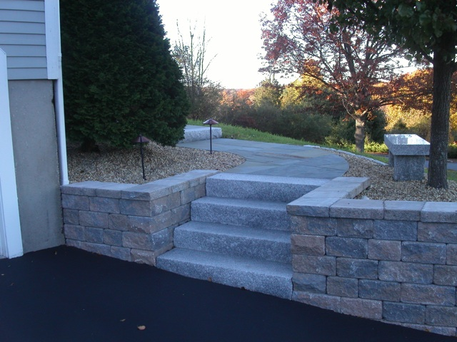 Wall building in ma natural path landscaping for Sloped driveway options