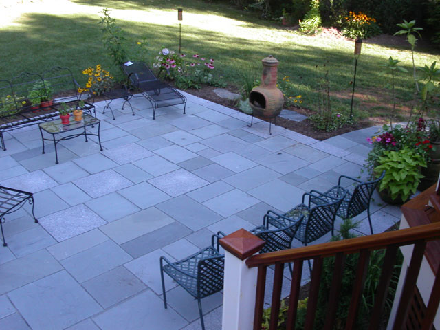 Bluestone Patio And Surrounding Gardens Sit Directly Below A Mahogany Deck.