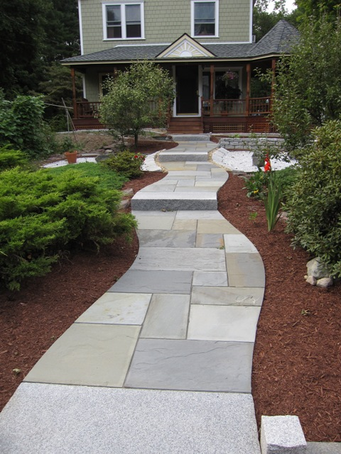A Climbing Walkway Of Full Color Bluestone And Granite Steps Flows Around  The Mature Plantings And Invites You To The Front Porch.
