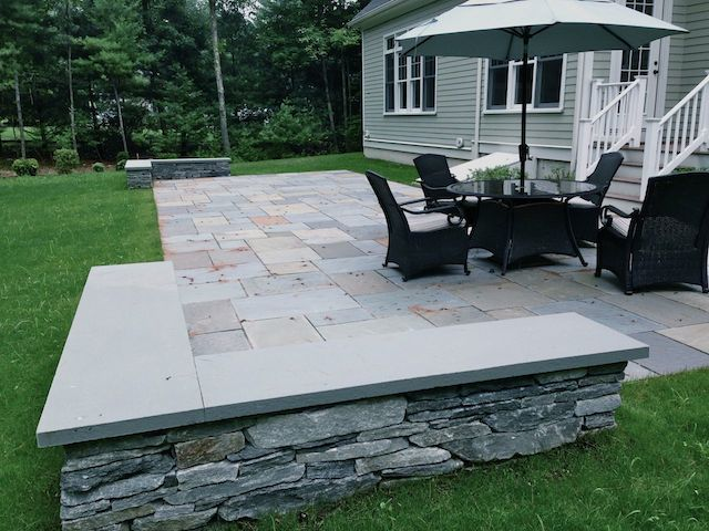 This Bluestone Patio Is 44u0027 Long With A Stone Sitting Wall On Opposite  Corners.