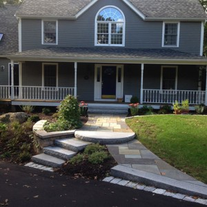 Double walkway with a curved granite step
